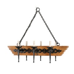 French Vintage Six-Light Wood and Ornate Iron Chandelier with Torch Style Arms