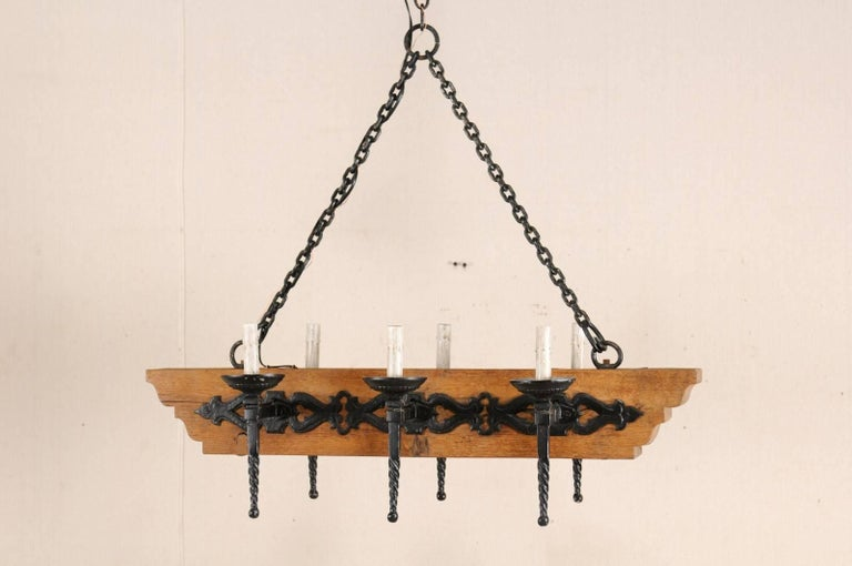 French Vintage Six-Light Wood and Ornate Iron Chandelier with Torch Style Arms For Sale 5