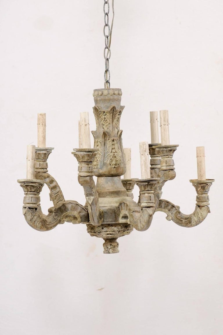 A French Ten Light Carved And Painted Wood Chandelier From The Mid 20th Century