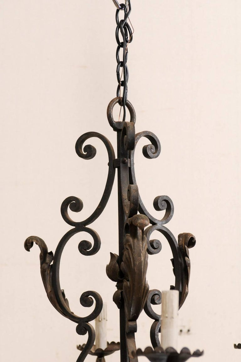 Metal French Mid-20th Century Scrolled Iron Chandelier with Six Lights For Sale