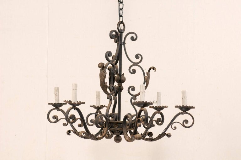 Forged French Mid-20th Century Scrolled Iron Chandelier with Six Lights For Sale