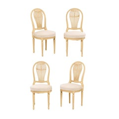 Set of Four French Louis XVI Style Painted Wood Balloon-Back Chairs