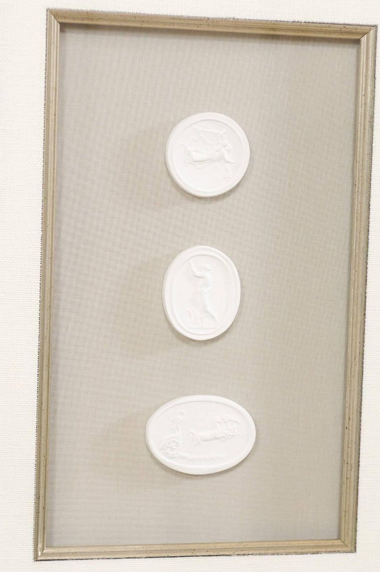 Contemporary Set of Four Wall Decorations of Hand-Cast White Intaglios in Silver Leaf Frames For Sale
