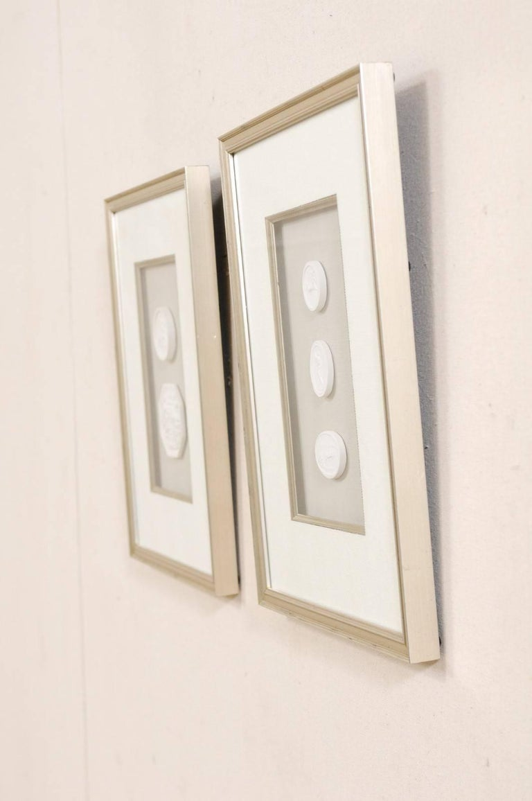 Glass Set of Four Wall Decorations of Hand-Cast White Intaglios in Silver Leaf Frames For Sale