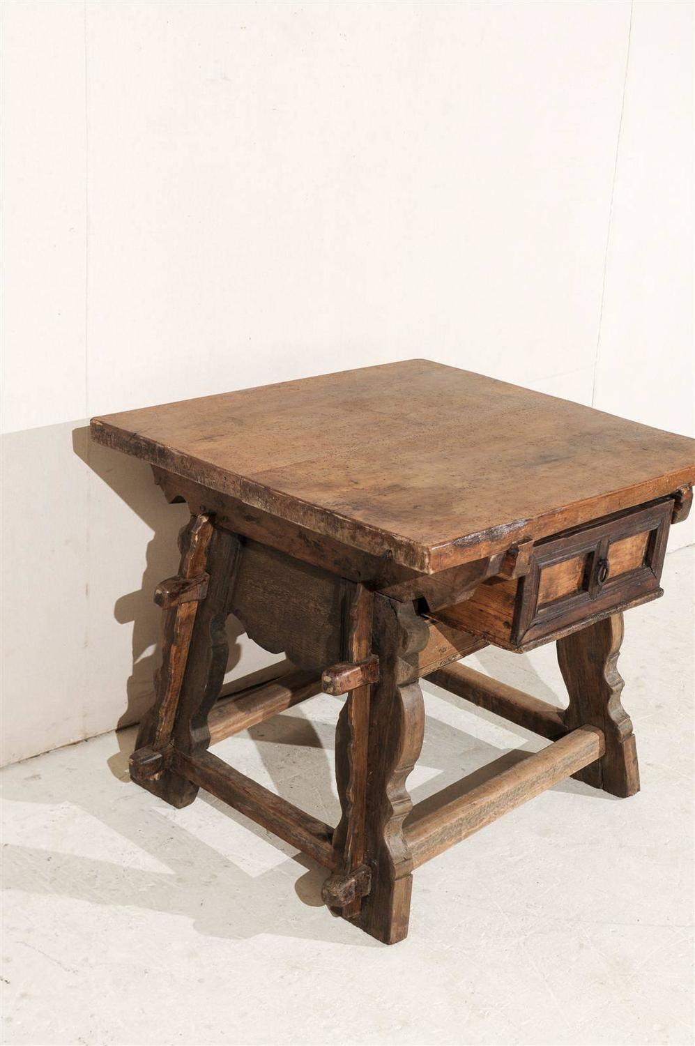 A 19th century walnut wood stretchered center table from for Table th center