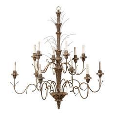 An Italian Twelve-Light Wooden Light Chandelier With Metal Twigs