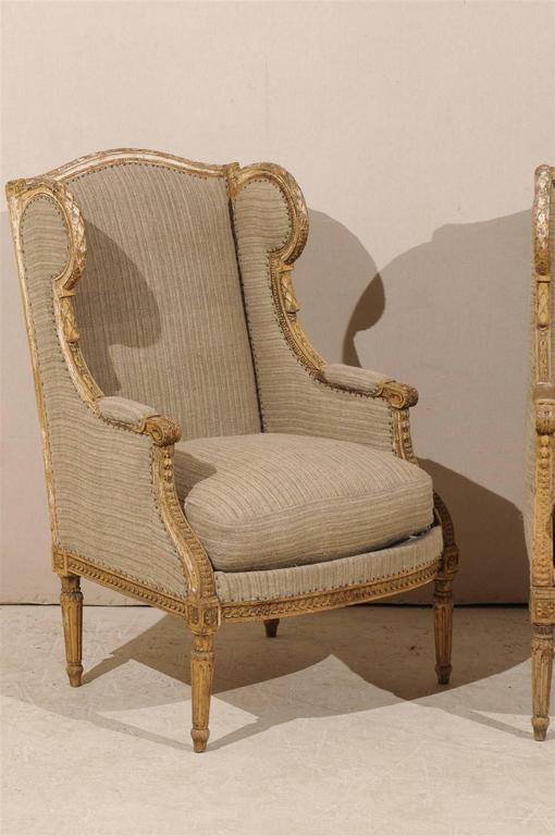 Pair of French 19th Century Louis XVI Style Wingback Chairs In Good Condition For Sale In Atlanta, GA