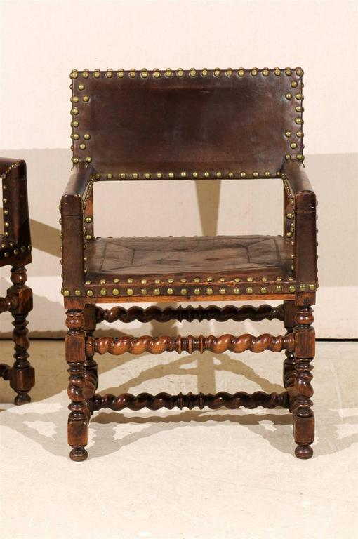 20th Century Pair of French 1920s Wood and Leather Armchairs with Turned Legs and Nail-Heads For Sale