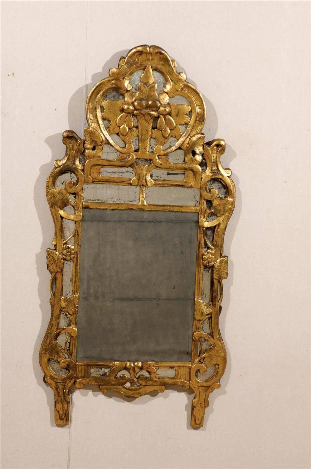 A french rococo style giltwood mirror from the early 19th for French rococo period