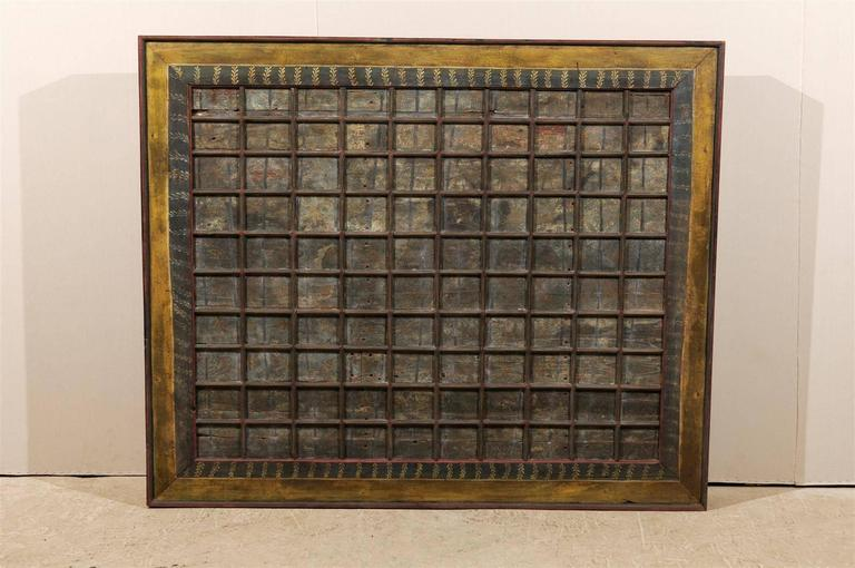 A 19th century carved wood southern Indian decorative ceiling panel. This wooden ceiling panel from the Tamil Nadu state features a delicate decor of painted flowers in the coffered sections. The surround is also decorated with floral motifs. The
