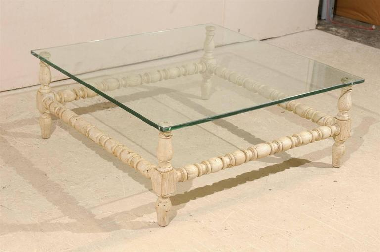 Ordinaire A Square Shaped Glass Top Coffee Table With Bleached Wooden Base. The  Wooden Base Consists