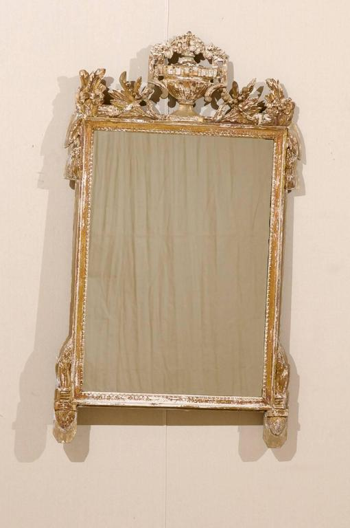 French Gilded And Ornately Carved Wood Mirror With Urn