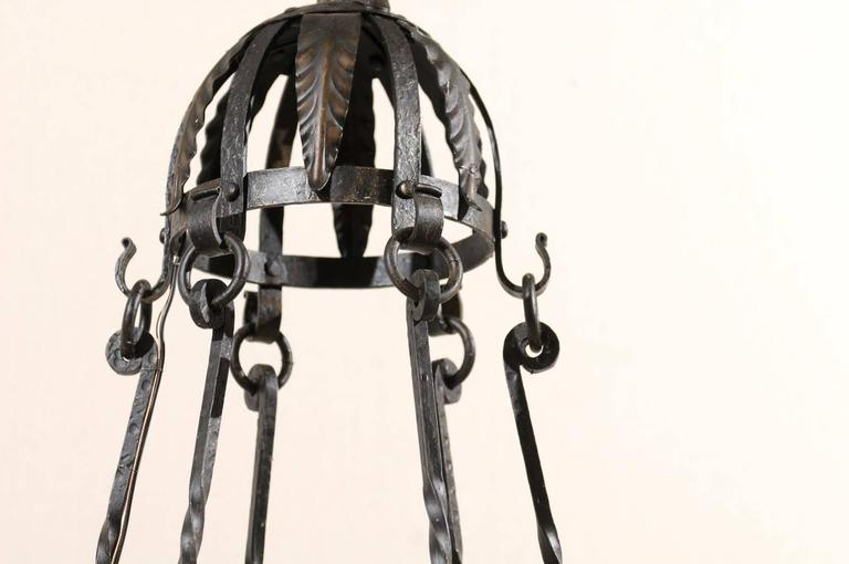 20th Century Italian Six-Light Black Iron Ring Chandelier with Scroll Motifs and Domed Canopy For Sale