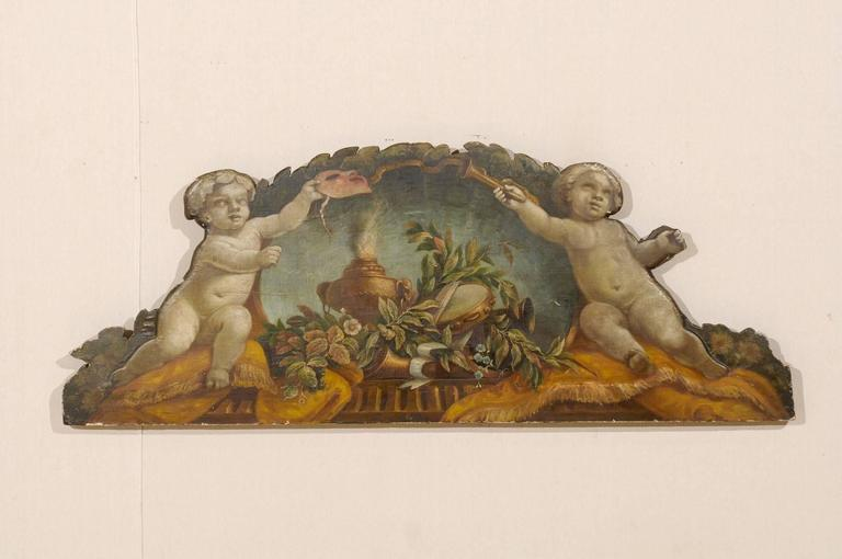 An exquisite 19th century Italian panel. This Italian panel is canvas over wood. It depicts the allegories of music and theater. In this Italian panel careful attention is paid to harmony and balance. Balance and harmony is created through the