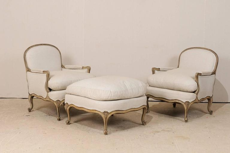 Three-Piece Set of French Bergères Chair Pair with Pouf / Ottoman, Neutral Tones 2