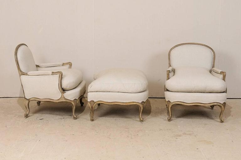 Three-Piece Set of French Bergères Chair Pair with Pouf / Ottoman, Neutral Tones 5