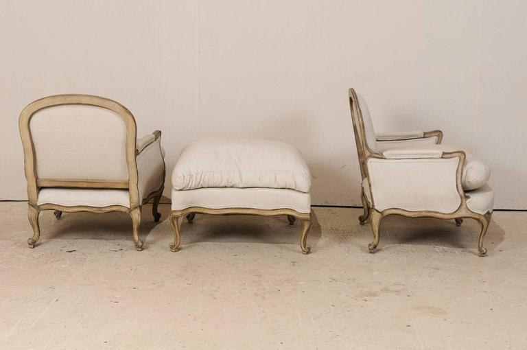 Three-Piece Set of French Bergères Chair Pair with Pouf / Ottoman, Neutral Tones 9