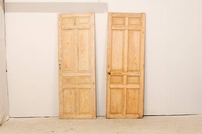 Pair of single french eight panel wood doors with natural for French doors both open