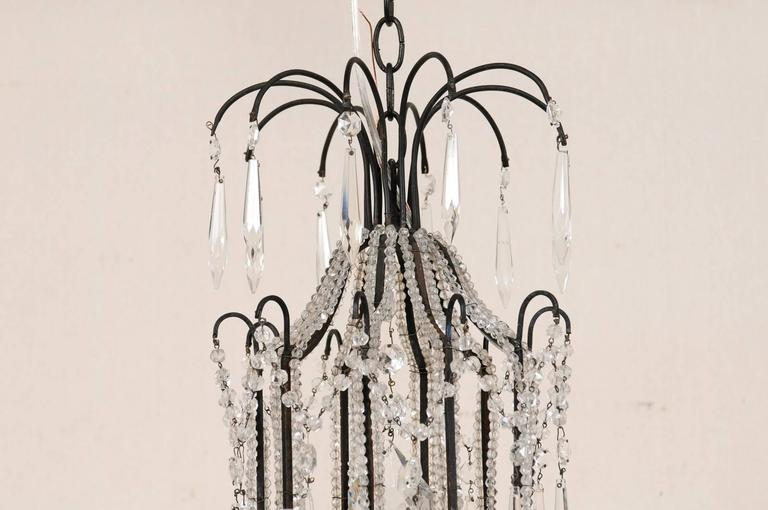 20th Century Italian Ten-Light Crystal Chandelier with Black Wrought Iron Armature For Sale