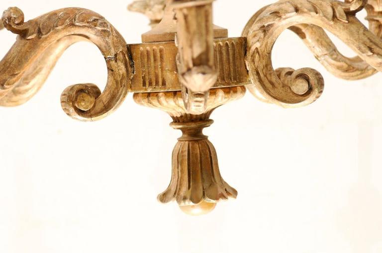 An Elegant Italian Early 20th C. Carved Wood Column Chandelier w/ Tassel Finial For Sale 4