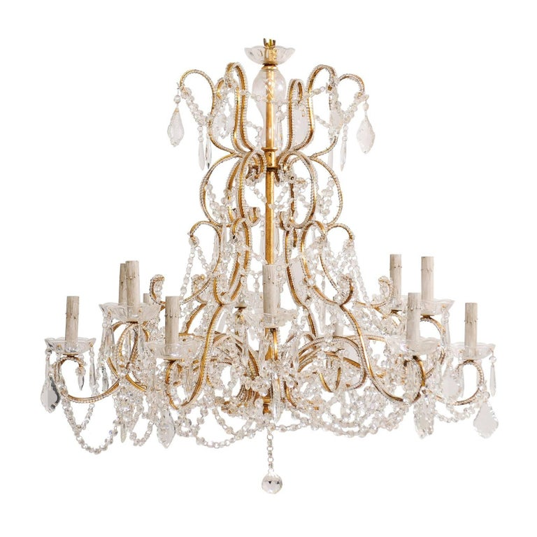 French Mid-20th Century Twelve-Light Crystal Chandelier with Gilded Iron Arms