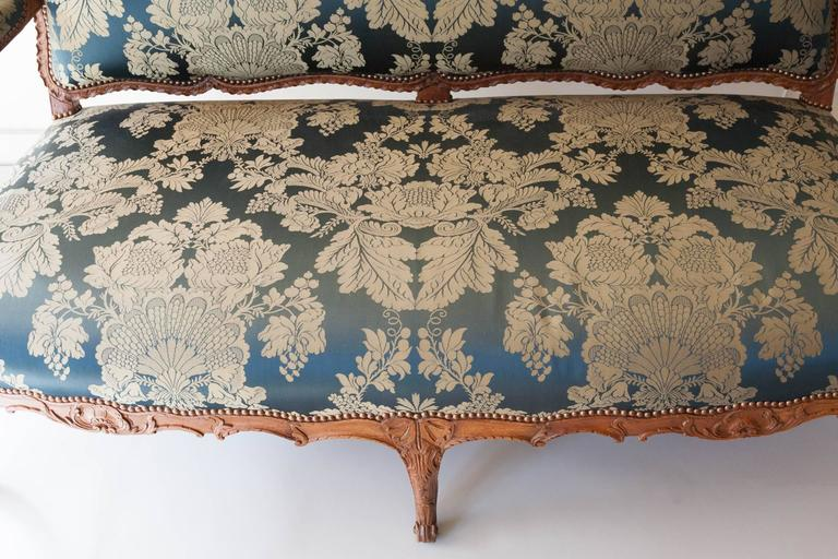 Louis xv period carved beech sofa or canap upholstered in for How to make canape shells