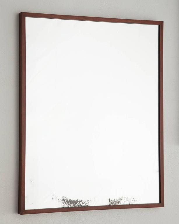 Mirror in jacaranda. Designed by Joaquim Tenreiro for a private commission in the Flamingo neighbourhood of Rio de Janeiro, Brazil, 1950s.