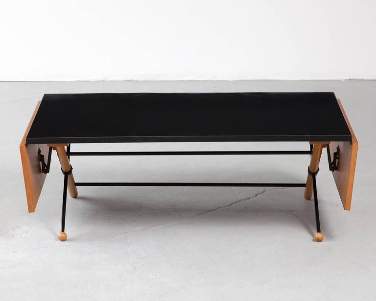 Coffee table in walnut, steel and plastic laminate with folding leaves. Designed by Greta Magnusson Grossman for Glenn of California, Los Angeles, 1952.