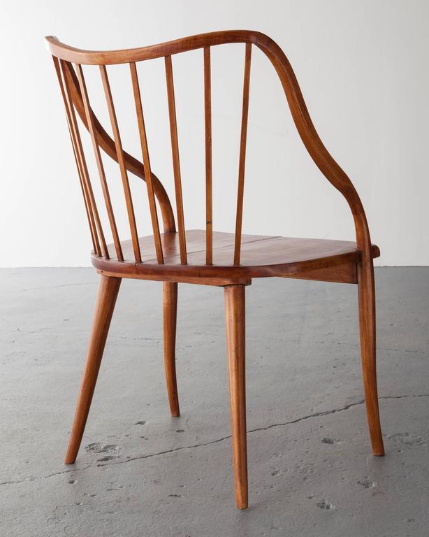 Side chair in Pau marfim (ivory wood) with undulating armrests. Designed by Joaquim Tenreiro, Brazil, 1948.