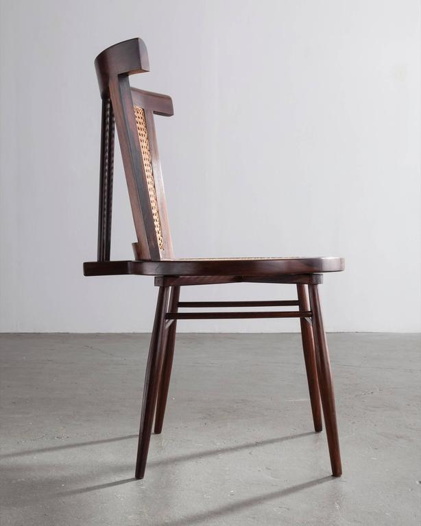 """""""Small Chair"""" in jacaranda with curved cane back, round cane seat and turned legs. Designed by Joaquim Tenreiro, Brazil, 1960."""