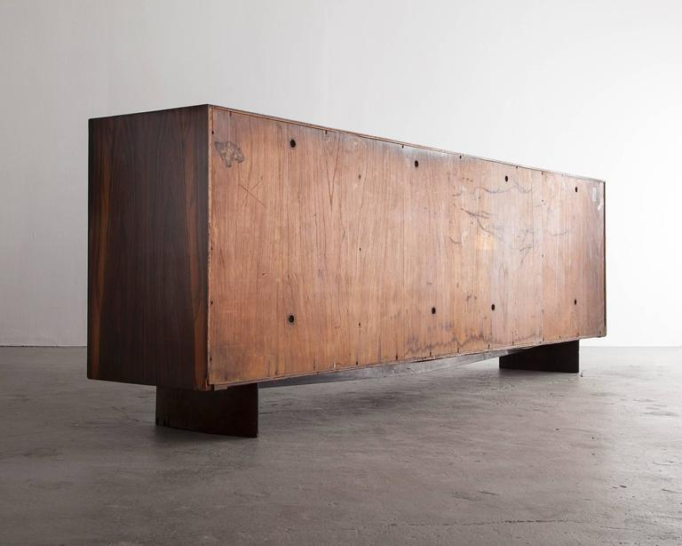 Brazilian Four-Door Credenza in Jacaranda with Red Formica Front by Joaquim Tenreiro, 1948 For Sale