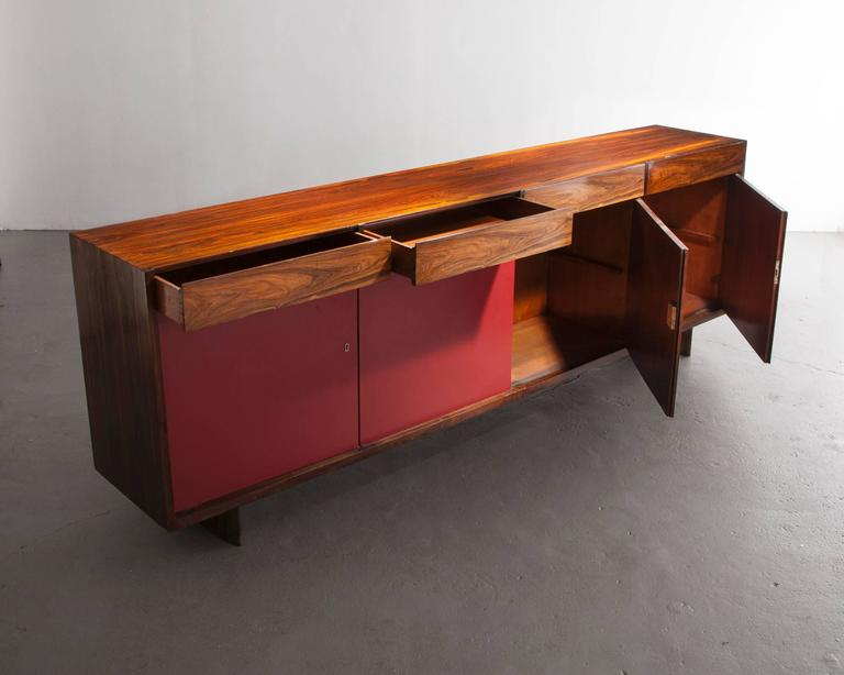 Four-Door Credenza in Jacaranda with Red Formica Front by Joaquim Tenreiro, 1948 In Excellent Condition For Sale In New York, NY
