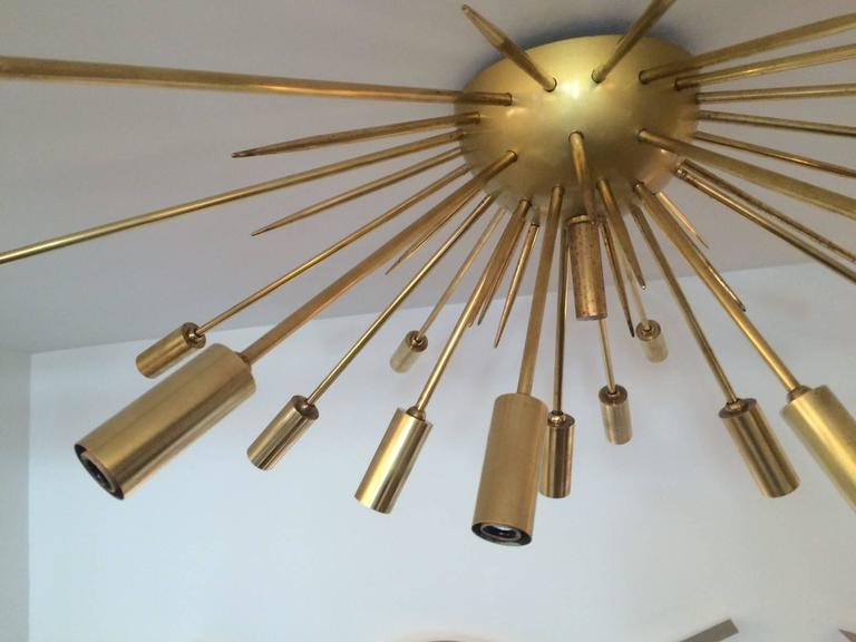 Iconic Sputnik as a ceiling flush mount fixture by Stilnovo.