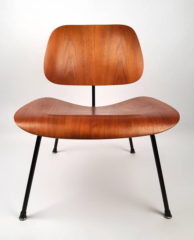Early Charles and Ray Eames designed LCM lounge chair with black iron base oiled walnut : boot chair - Cheerinfomania.Com