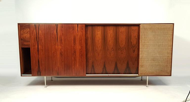 Rare Brazilian rosewood cabinet by George Nelson for Herman Miller with drop front panel that opens to reveal the original Garrard RC-80M Turntable and Harmon Kardon Festival Mullard El 37 Tube powered integrated receiver. Both Electronic pieces are