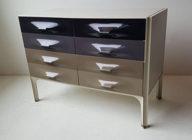 Futuristic DF-2000 chest of drawers designed by the father of 20th century Industrial Design, Raymond Loewy. Six drawers total with vacuum formed plastic handles.