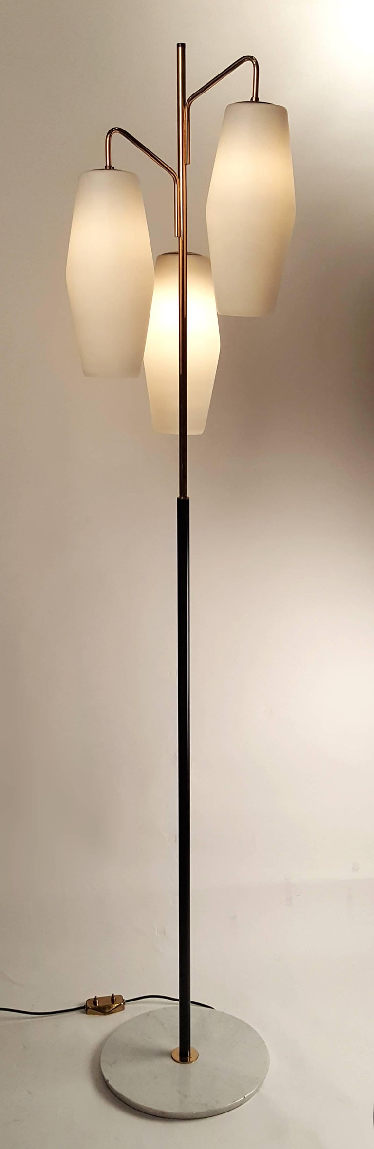 Frosted glass shades suspended on a gilt and black lacquered metal stem on a Carrara marble base with original foot switch. Stilnovo hallmark impressed into the steel to which the shades mount. Completely rewired.