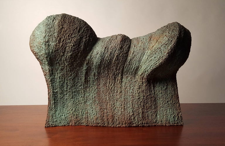 20c design is proud to represent this phenomenal abstract waveform sculpture created by contemporary artist Douglas Ihlenfeld. It is crafted from hand-welded bronze with an applied verdigris patina. This sculpture represents a tremendous amount of