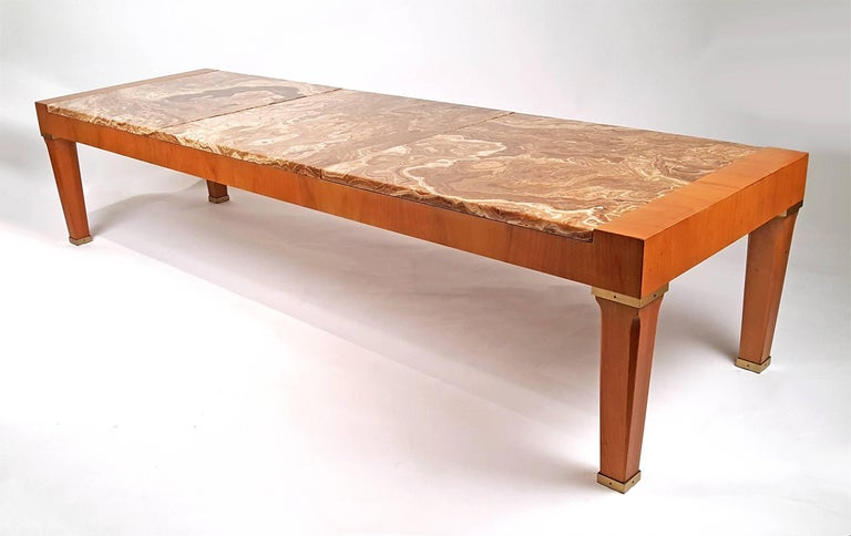Vintage baker coffee table with gorgeous exotic onyx marble tops and mahogany frame with brass detailing.