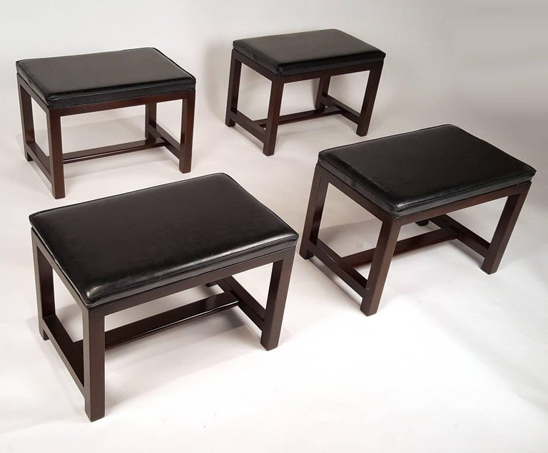 We are offering two pairs of Dunbar stools with vinyl tops and mahogany bases. They would work well as footstools for your sofa or favorite chair. There is a rectangular Dunbar label intact on a few of them. They are being sold in pairs. The list