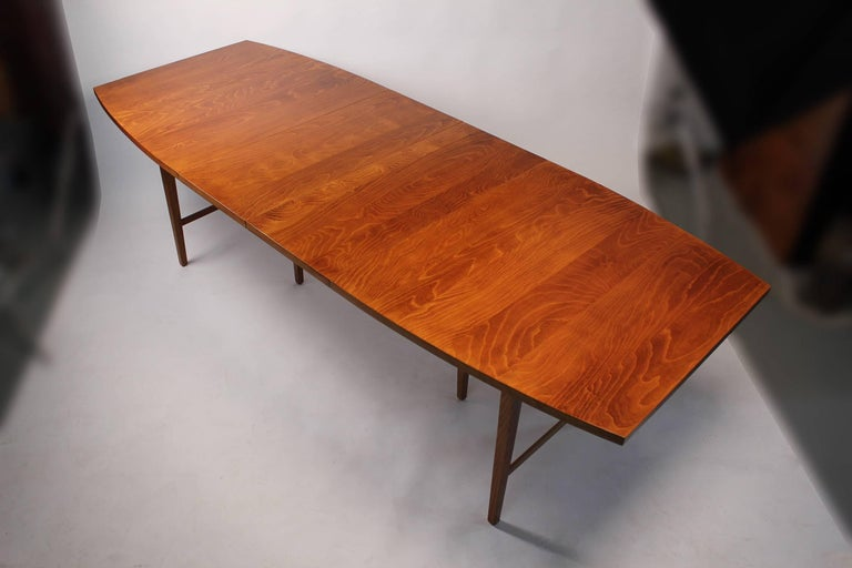 1960s Paul McCobb designed perimeter group dining table with two leaves. The maple top is absolutely incredible on this piece. The striations in the wood grain are very exotic. When both leaves are in place the table measures 96