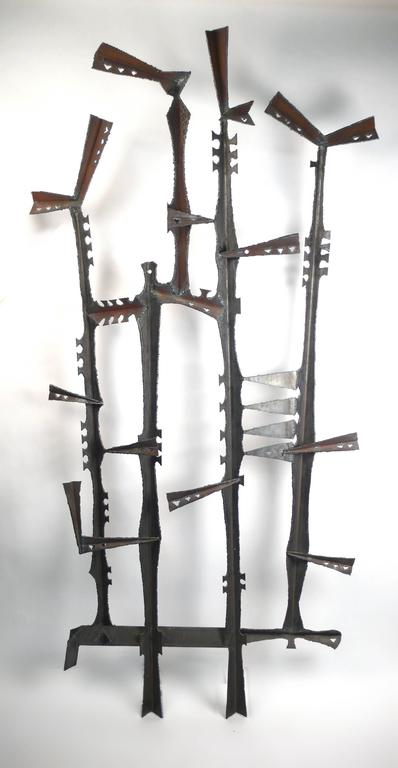 Incredible Brutalist torch-cut wall mountable sculpture by artist Gene Montez Flores. Designed to hang as shown. Produced during in the early 1960s in his California studio. Has never been displayed outdoors.