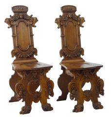 Pair of 19th Century Flemish Carved Oak Hall Chairs