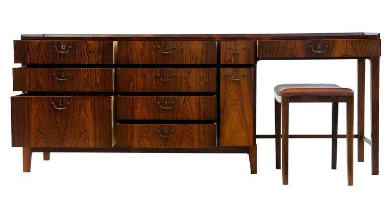 1960s Danish design rosewood dressing sideboard by Frode Holm  Rosewood veneered sideboard by Frode Holm, circa 1960 One of the 20th centuries finest Scandinavian designers Striking veneers with numerous drawers of varying size with swan neck