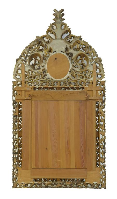 Stunning carved cushion mirror, circa 1910. Profusely carved mirror with real gilt. Original plates Beautifully carved with no losses, top section is removable.  Measures: Height: 74