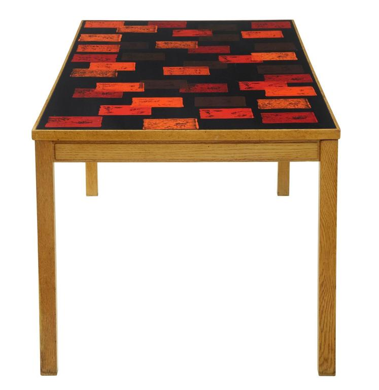 Collectable table by David Rosen, circa 1963. Enamel top signed by the creator p torneman. Makers label underneath with date stamp. Wood work would benefit a strip and repolish to restore to former glory, enamel top is in good order with minor