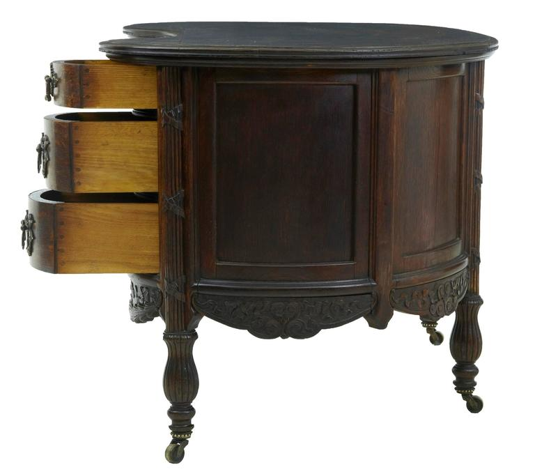 Late 19th Century Carved Oak Kidney Shaped Writing Desk At