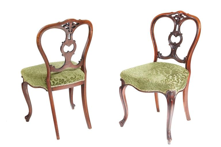 A good set of six victorian dining chairs with shaped backs having delicately cartouche and scroll carved crested center, newly re-upholstered serpentine seats,nice shaped carved cabriole legs to the front outswept back legs.
