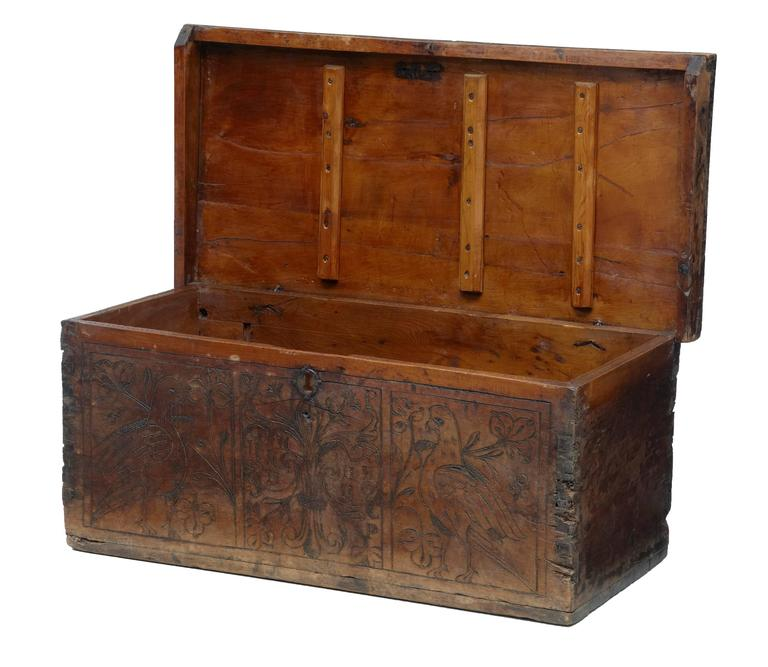 Small walnut marriage chest, circa 1700. Poker work on the front with initials in a fleur de lys design, flanked either side by doves. No lock present. Top with extensive restorations, hard wax to age splits to top and later woodwork supports on