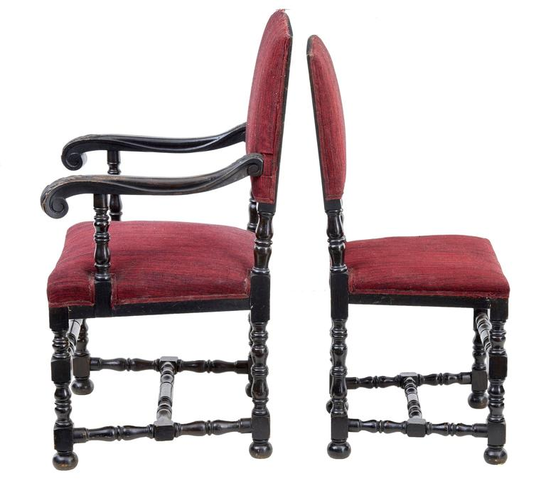 European Set of Ten and Two Early 20th Century Baroque Influenced Oak Dining Chairs For Sale